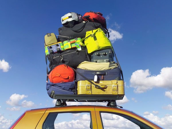 luggage placed on the top of the car