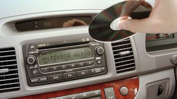 Putting a CD into car sound system