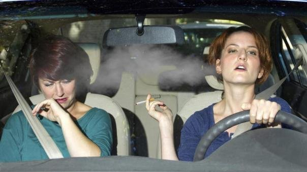 A woman smoking in a car