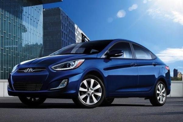 Angular front of a blue Hyundai Accent