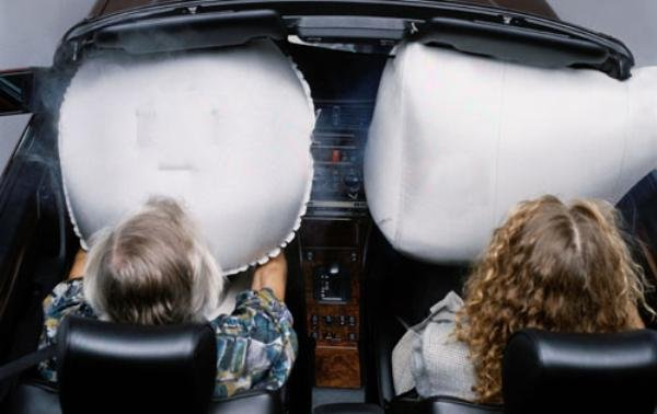 Children with airbags in a car