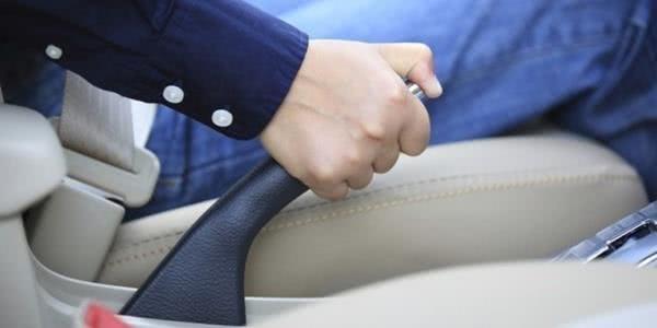 a male holding car handbrake