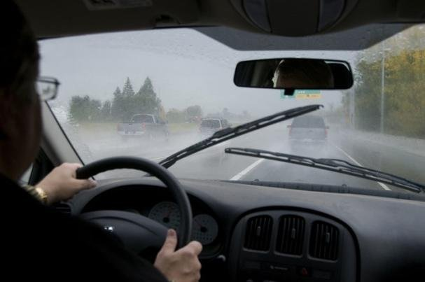 a driver driving a car in storm