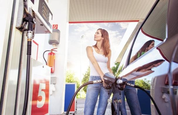a girl filling fuel