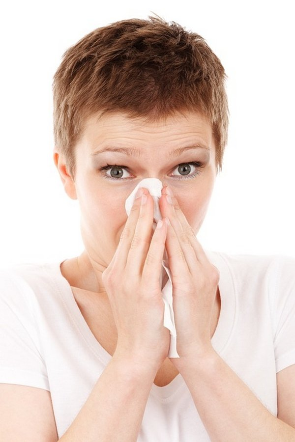 a woman suffering from allergies