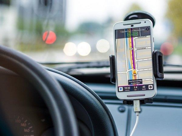 A smartphone using navigation app on a car
