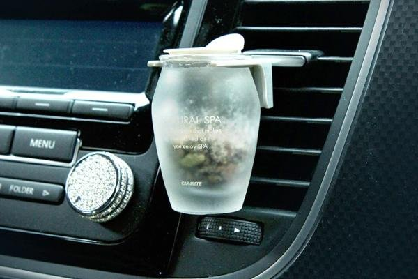 A car freshener attached to the air vent