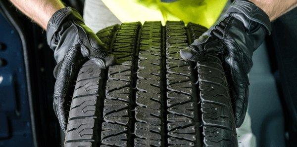 checking tread wear on car tire