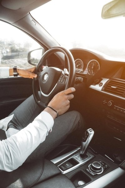 a driver holding a steering wheel