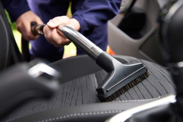 Cleaning a car interior with vacuum