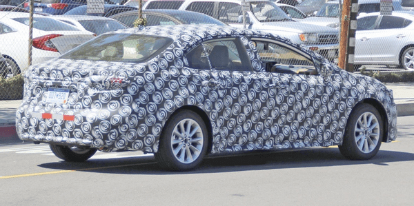 The angular rear of the Toyota Corolla 2019 sedan in camouflage