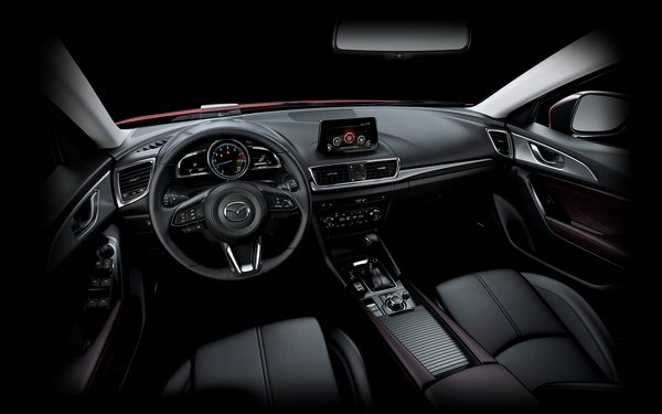 2018 Mazda 3 Interior. Domintaing The Inside Is A Black Theme With Dark  Brown Leather Highlights On Door Panels And Center Console