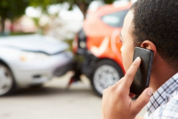 a driver calling at a car accident