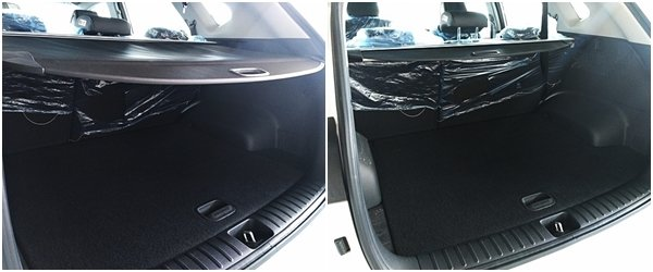 Rear cargo bay with screen deployed and Rear cargo hold with removable screen rolled up on 2018 hyundai tucson