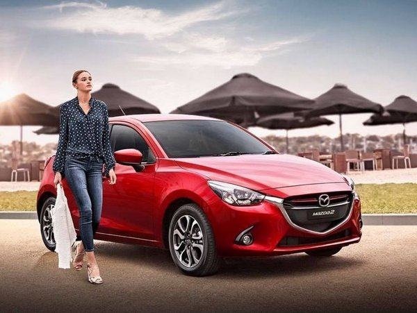 a girl and the mazda 2 2018