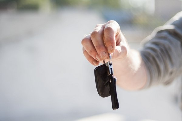 a car owner holding his car key