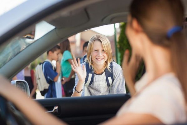 a mom drive off her kid to school