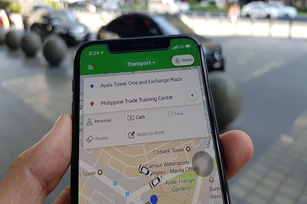 using grab taxi app on smartphone