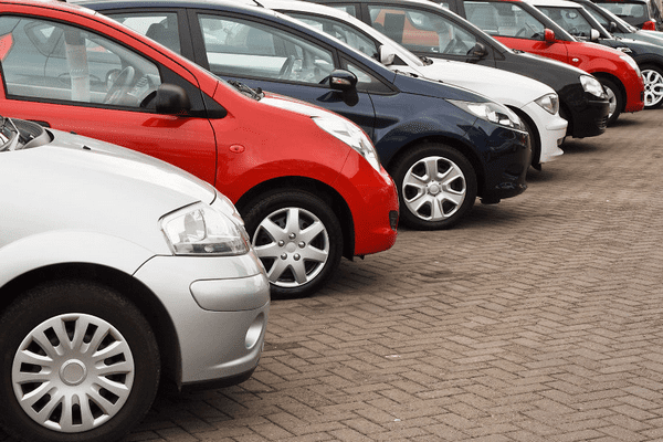 a line-up of cars for sales