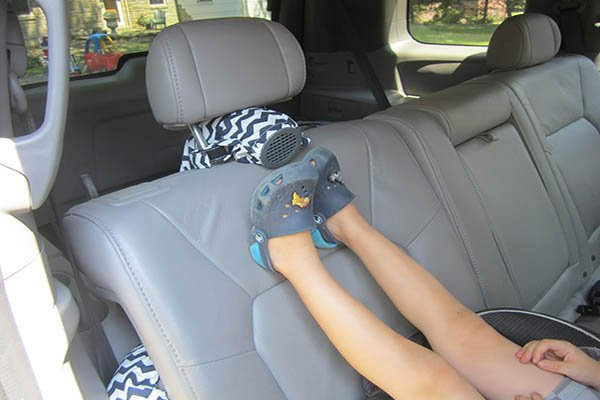Feet upon the car seat