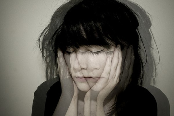 Girl dizzily holding her face