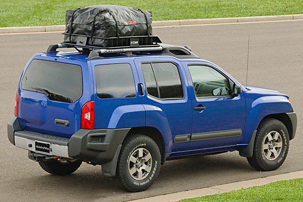 A car with luggage on its roof rack