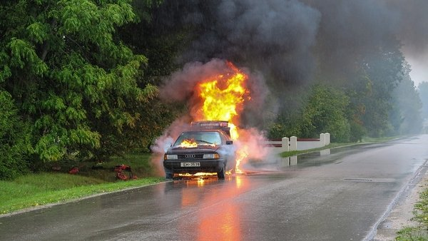 a car on fire on the road