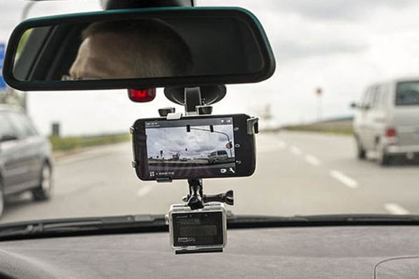 Action camera converted into dash cam with connected mobile