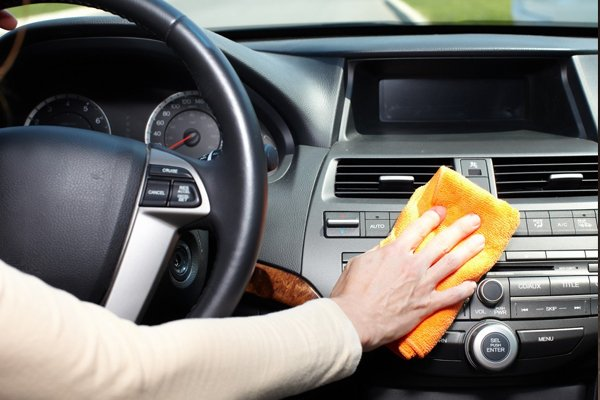 Cleaning a car's dashboard