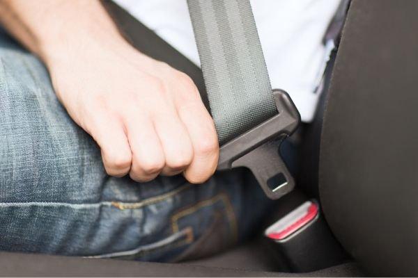 fastening seat belts in car