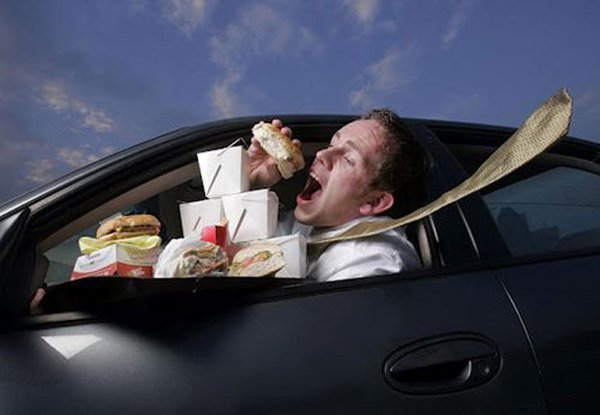 a men eating while driving