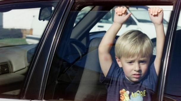 A kid in a car