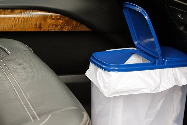 A trash bin located inside the car to keep it clean