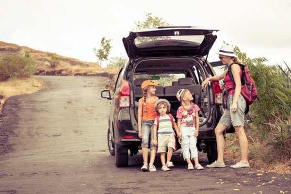 family with their car out on a roadtrip