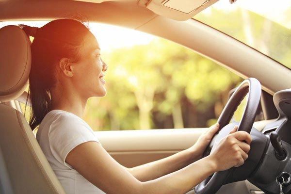 a wonan driving a car