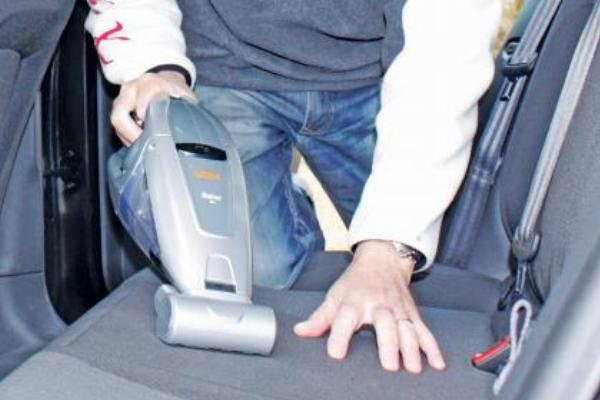 Cleaning car seats' surface by a vacuum cleaner