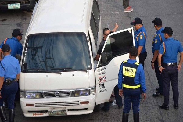 colurum vehicles being inspected by the MMDA