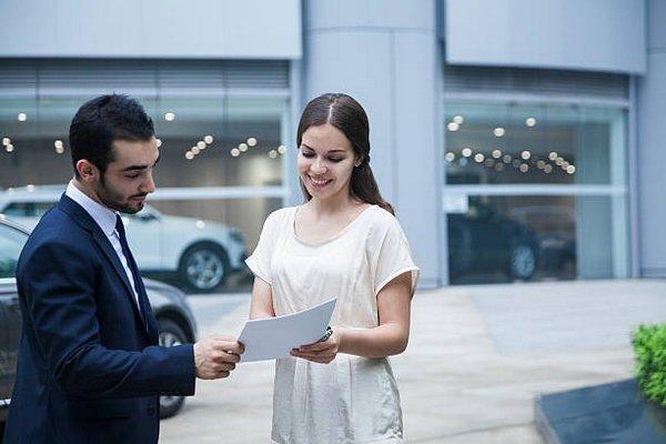 women buying car and car salesman