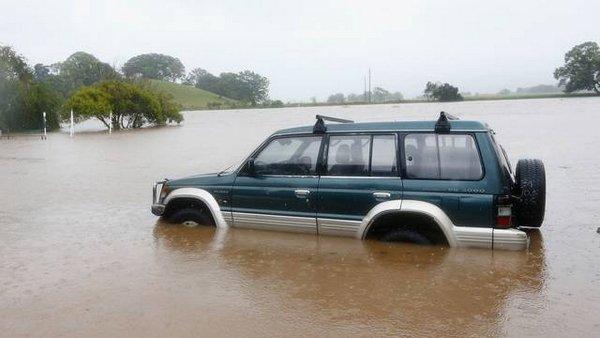 a mitsubishi wading through flood