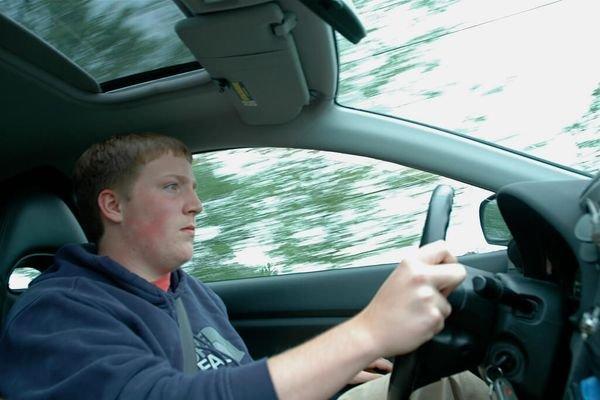 a boy driving car