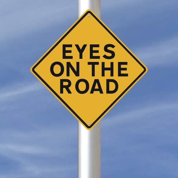 Eye on the road sign