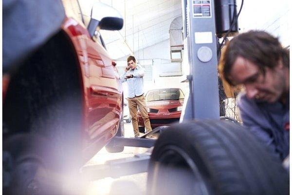Man changing car tires