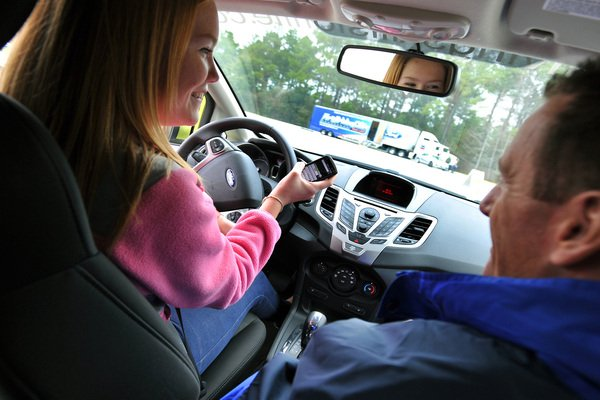 Father teaching his kid to drive