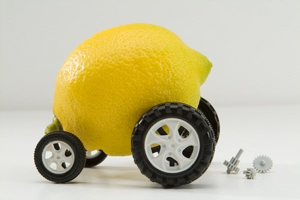 Explanation of Lemon law meaning by a car made from lemon