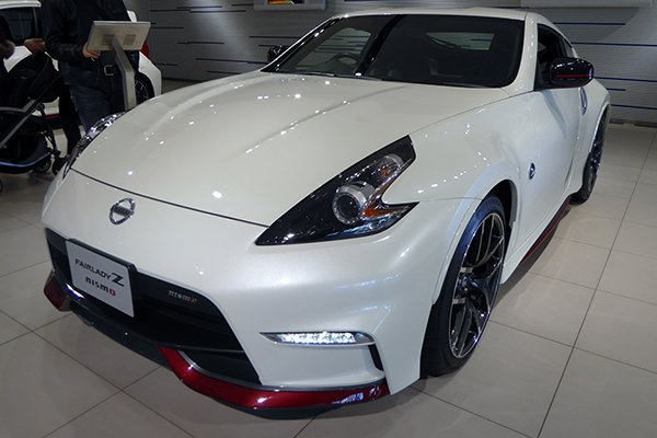 A front view of the Nissan 340z at a Japanese car show.