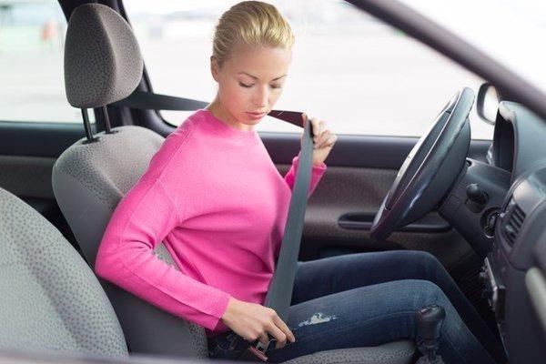 Woman wearing seat belts