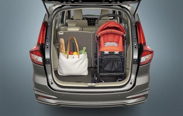 The rear door of the Suzuki Ertiga 2019 opened to show the trunk