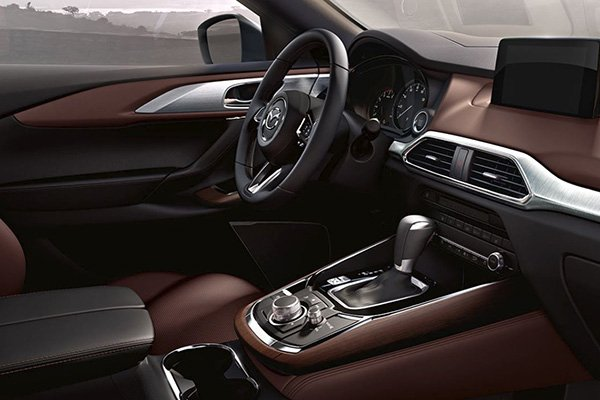 An alternate picture of the Mazda CX-9 2019 interior highlighting the dash, the steering wheel, and the infotainment system