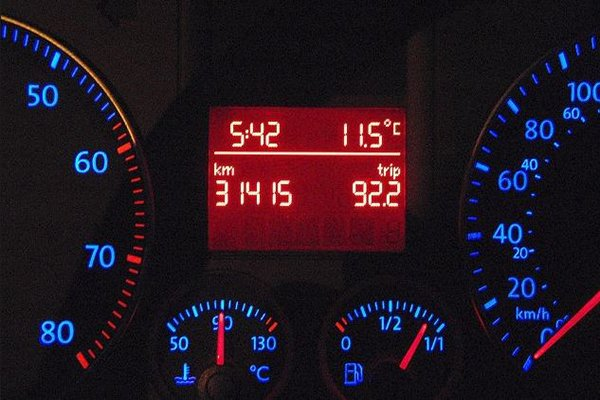 A picture of a digital odometer glowing in the dark