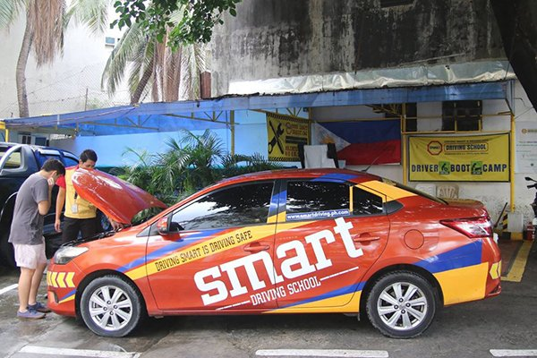 A picture of a student with his instructor at Smart Driving School